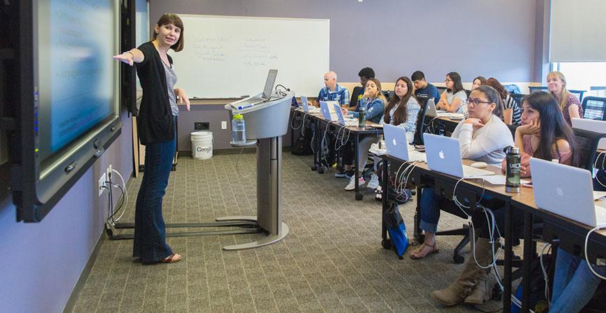 Instructor teaching on a smart board